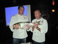 Chefs Tim Creehan (left) and Phillipe Parola with a bighead carp