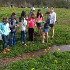 Notre Dame Biology Graduate Students, Brittany Hanrahan and Martha Dee, teach young scientists about aquatic ecology as part of the Science for Ambitious Girls Program.