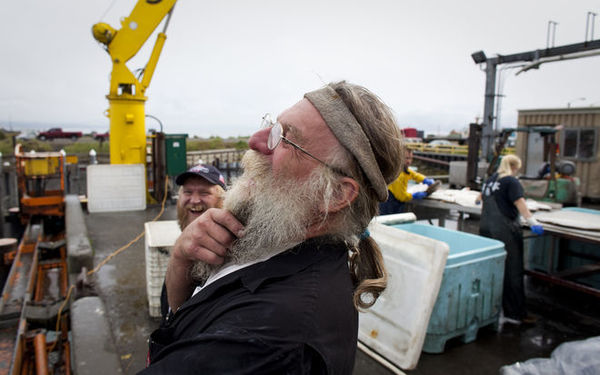 Dan Anderson shares a laugh with friends at the dock in Homer, Alaska